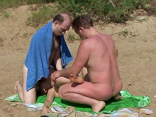 Two Guys Are Fucking This Teen On The Beach