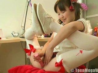 Asian Teen Dresses As Schoolgirl